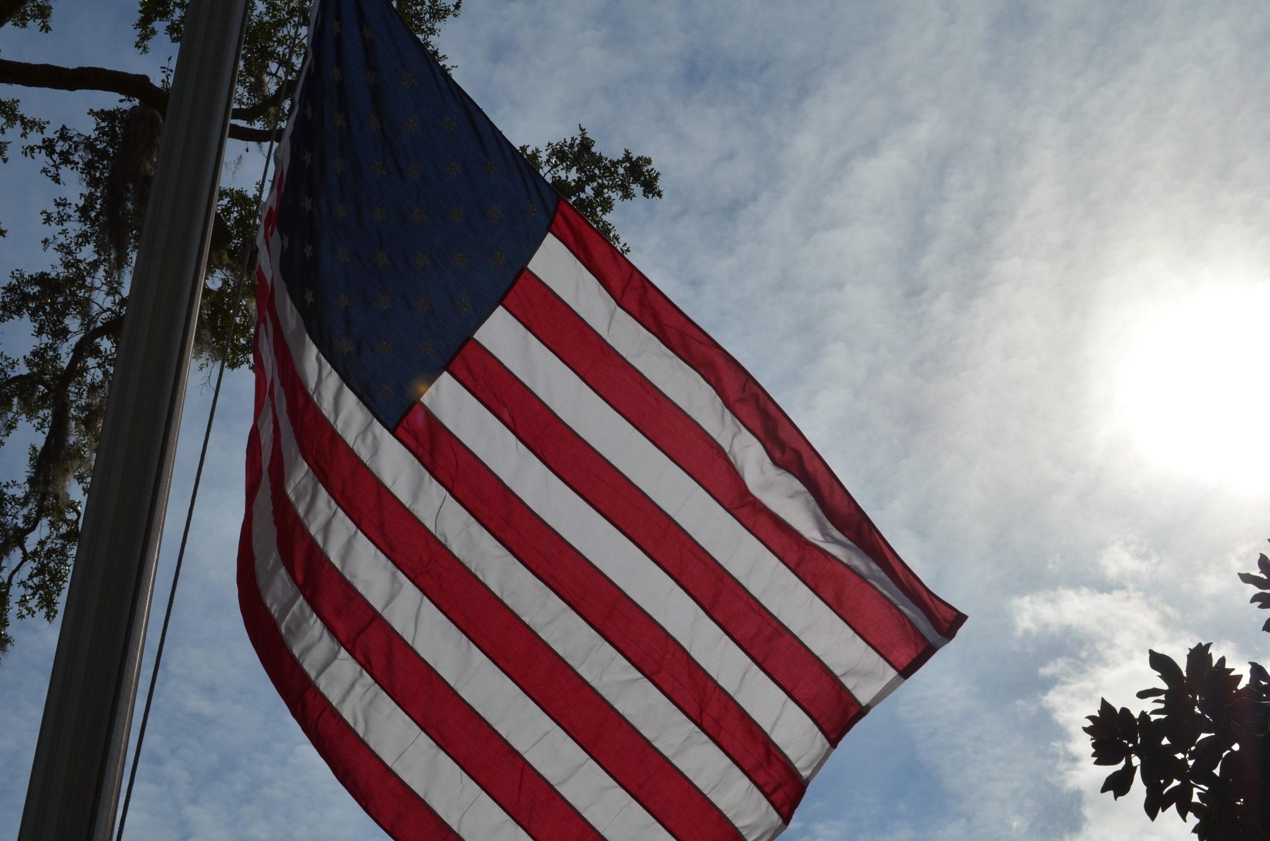 American flag over blue skys
