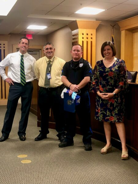 M Altman employee of the month with the mayor, police chief, and City admin