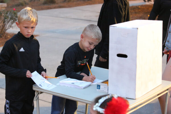 Children dropping letters to Santa in a box prior to his arrival