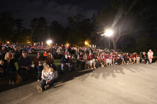 A large crowd seating awaiting the arrival of the big guy, Mr. Clause