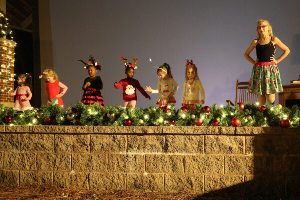 Children dancing and smiling on stage
