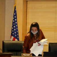 Clerk of Council Emily is preparing for the meeting and arranging papers