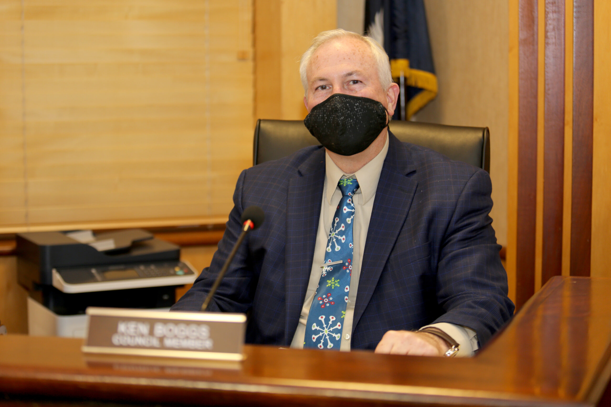 Councilman Boggs appears to be smiling from behind his mask