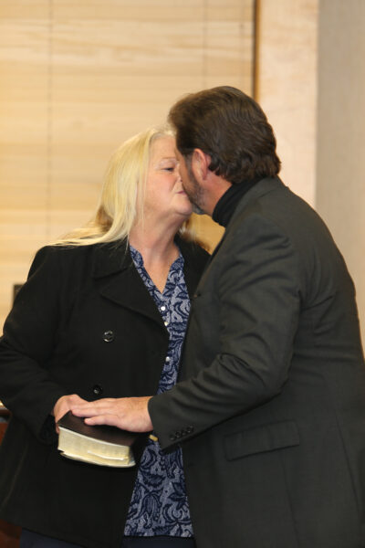 Mayor Pro-tem Chandler celebrating being sworn in with a kiss with his wife